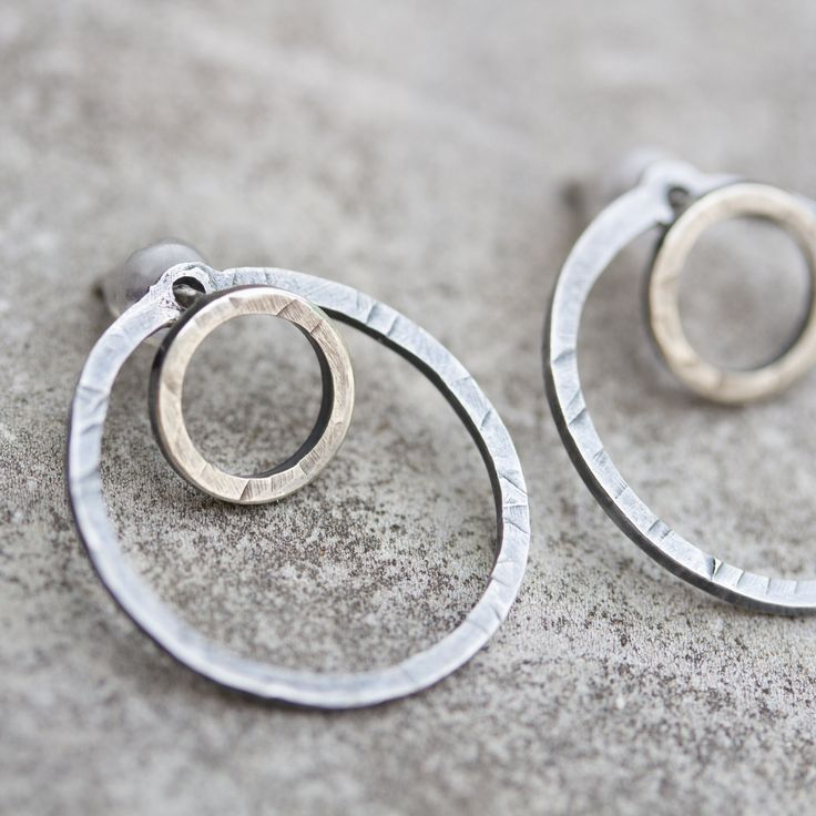 These wonderful earrings are a great modern piece for a person having a special taste for minimalistic style. These double sided stud earrings are made of sterling silver. The surface is oxidized and