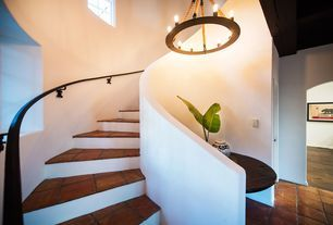 Southwestern Staircase with terracotta tile floors, Chandelier, High ceiling