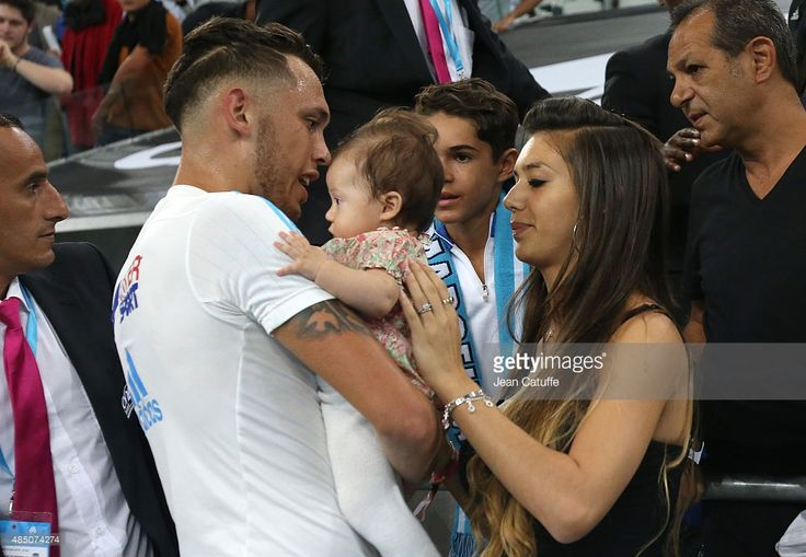 Lucas Ocampos of OM and his girlfriend Majo Barbeito hold their daughter Luisana Ocampos (4 months old) after the French Ligue 1 match between Olympique de Marseille (OM) and Troyes ESTAC at New Stade Velodrome on August 23, 2015 in Marseille, France.