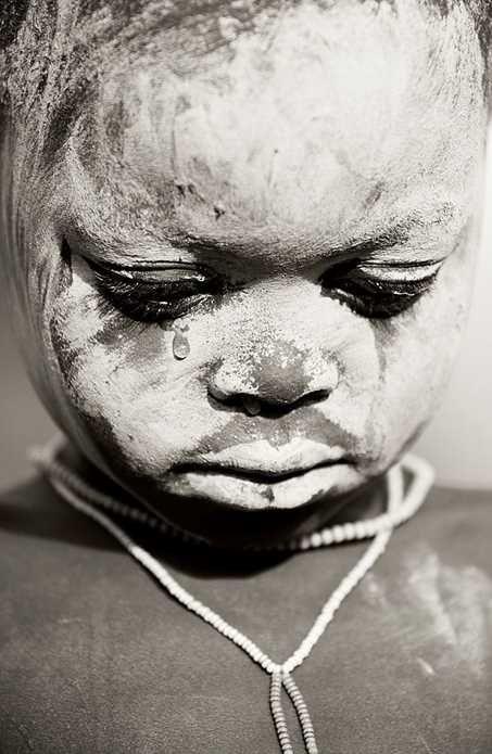 "Africa | ""The tear"". Surma child. Omo Valley, Ethiopia | ©Carlo Mari"
