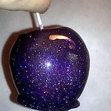 Instead of caramel apples this Halloween, melt jolly ranchers in a 250 degree oven for around 5 minutes, then pour over your apples. Add edible glitter for the sparkling space effect!