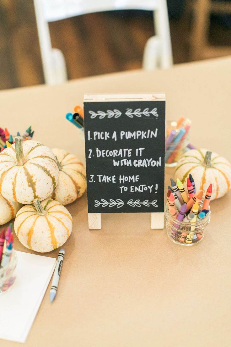 At this wedding, young guests were kept occupied with a pumpkin-decorating station. The simple, fun activity required just mini squashes and Crayons.