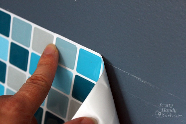 Mosaic Tiles that look real and you just stick on.  They are called Smart Tiles.