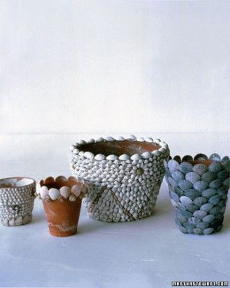 Shell Flowerpots  Kids will love making these beachy terra-cotta plant pots using snail shells, Atlantic cockles, quahogs, or black calico scallops.  Use craft glue or hot glue to attach shells of uniform size. Start with a ring of shells at the top (shells should extend above the rim of the pot) and work downward, placing each successive row about halfway down the shells on the previous ring.
