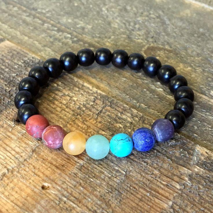 Matte chakra gemstones chakra bracelet. Simple and cool for balancing your chakra energies, made with high quality ebony mala beads and matte gemstone beads, red jasper, carnelian, yellow jade, aventu
