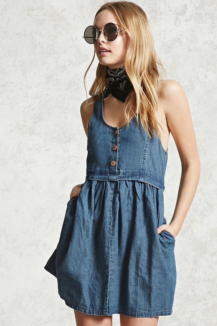 A clean wash denim dress featuring a round neckline, partial button placket, on-seam pockets, sleeveless cut, and shirred skirt.