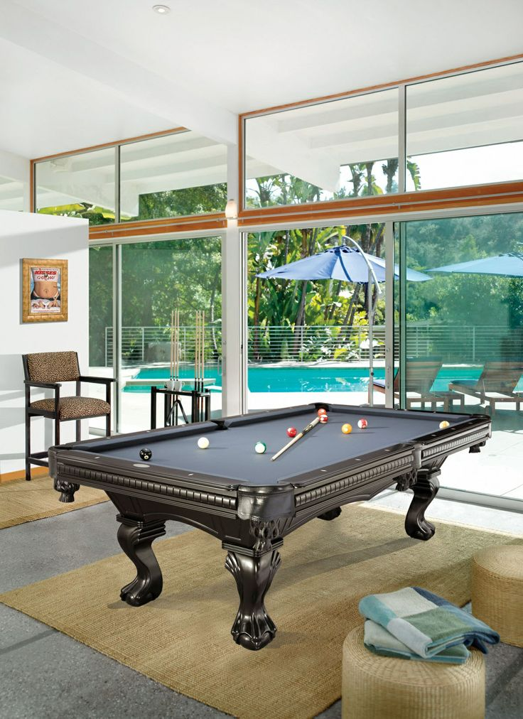 A POOL HOUSE IN THE SAME STYLE OFF TO THE SIDE OF THE