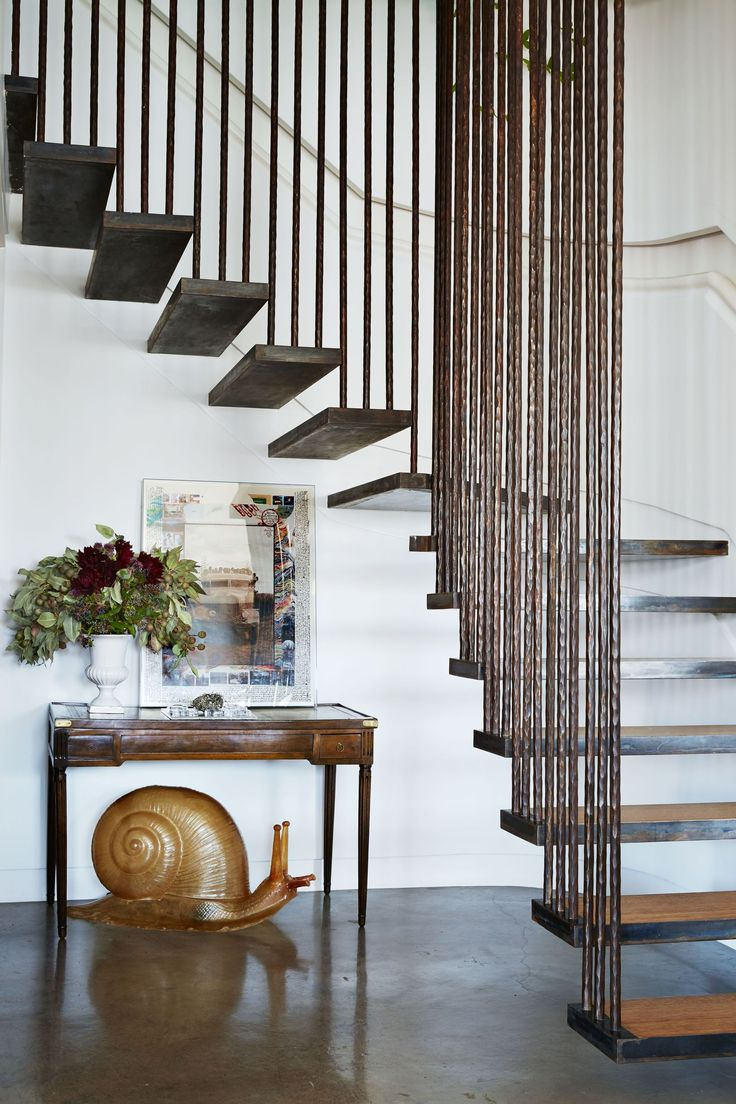 16 Clever Ways To Style That Awkward Space Under Your Stairs