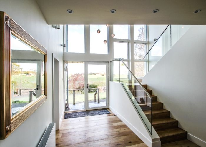 A hall with a stunning view through the Idealcombi Nation windows and entrance door.