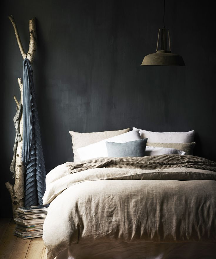 Charcoal wall. I love dark walls in bedrooms, and the branch is beautiful too.