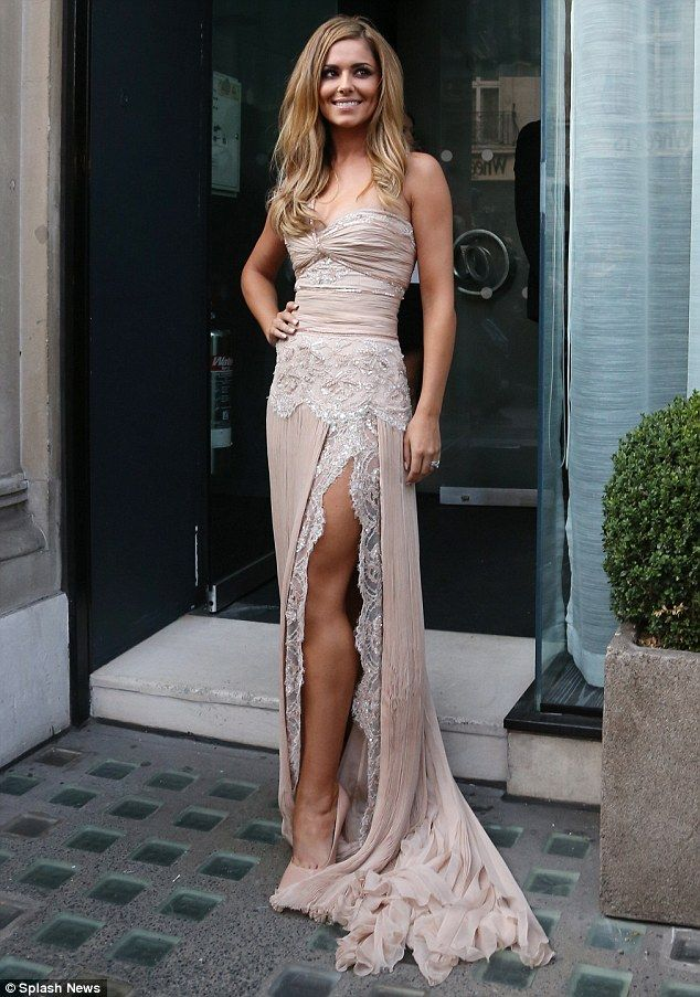 Here she comes! Cheryl Cole arrives at Avenue in central London as she prepares to launch her debut fragrance, StormFlower