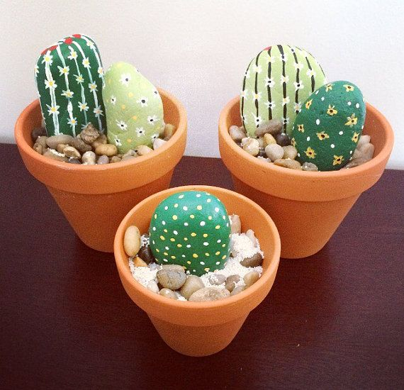 Can you tell these cactuses are not real? ROCK THE HOUSE WITH THIS ONE OF A KIND DECORATION!! Have the beauty of cactus bowl without the fuss, thorns and hassle of watering it. One of a kind decoration! Use it in your home, at your door steps or in your garden.  Stones are carefully selected and hand picked at rocky shores of New Yorks Long Island sound, steam washed, hand painted and finished with clear polish spray to prevent chipping and to add luster. Then placed in a clay pot with…
