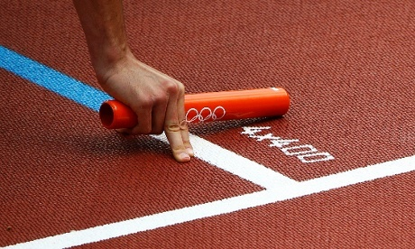 South Africa's Shaun de Jager holds the relay baton at the start of the men's 4x400m relay round 1 heat