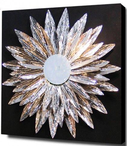 Барельеф-коллаж из тонких металлических пластин, обработанных вручную и собранных в виде звезды, в центре зеркальное полотно, на основе из чёрного лакированного дерева. А также стильные зеркала, мебель из стали, фонтаны-водопады и современные светильники от испанской фабрики SCHULLER на сайте  http://elpaso-studio.ru/1_schuller?