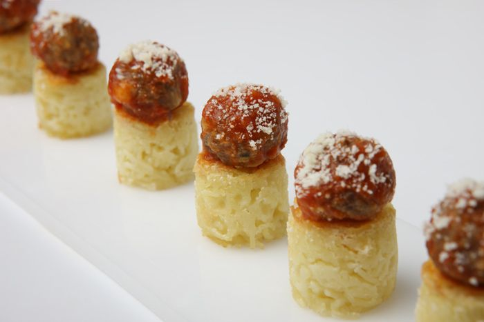 Easy-to-eat mini spaghetti nests, topped with a micro meatball and marinara and sprinkled with Parmesan, by Elegant Affairs in New York  Photo: Jan Van Pak Photography