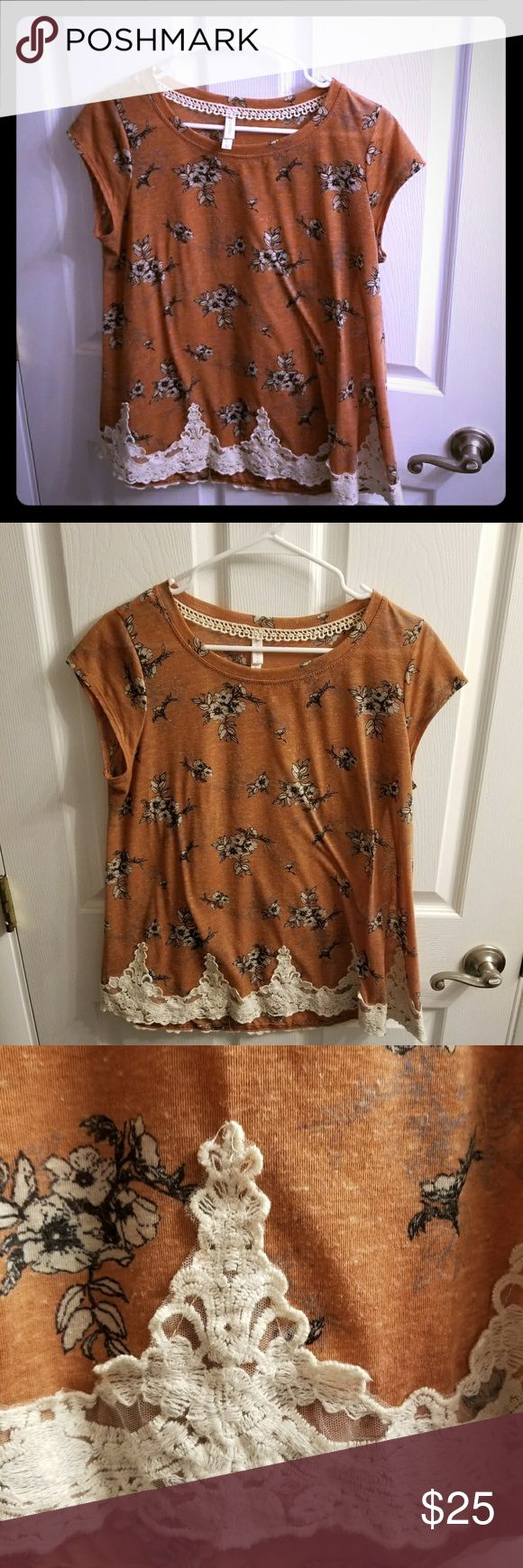 Lace Detail Top Cute lace trim on the bottom. This top fits more like a L although it is an XL.  The sides flare out a bit to give a flowy look. Color is pinkish orange, more on the nude colored side. Gently used, tiny bit of pilling, in good condition. Xhilaration Tops Tees - Short Sleeve
