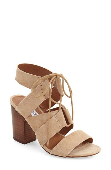 emalena ghillie sandal by Steve Madden. Crisscrossed ghillie laces span the  open top of a suede sandal lifted by a blocky, stacked woodgr.