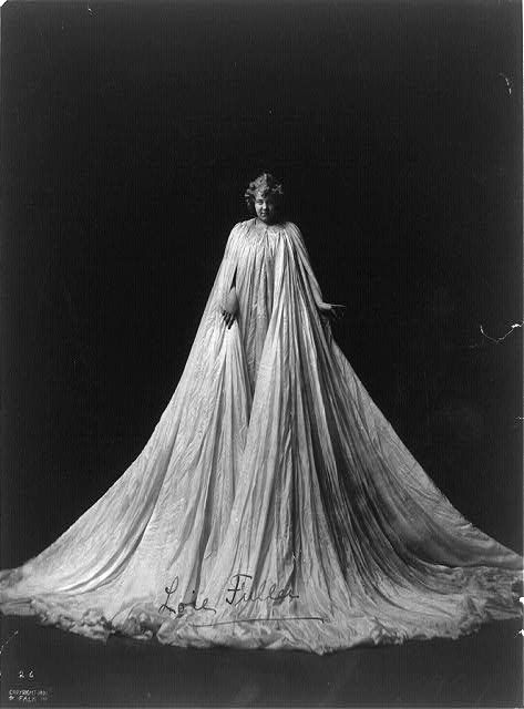 c1901.[Loie Fuller, full-length portrait, standing, facing front; draped in very long gown]