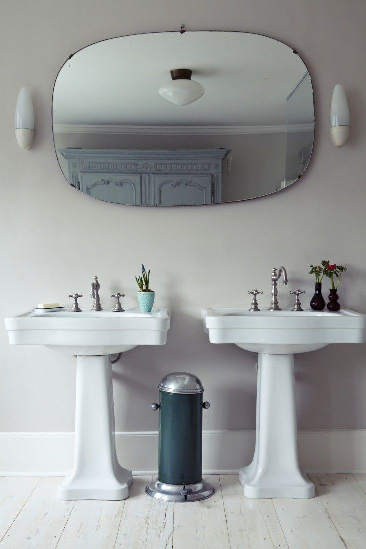 Double Pedestal Sinks In Bathroom, Diffuse Ceiling Light With Sconces On  Either Side Of Mirror