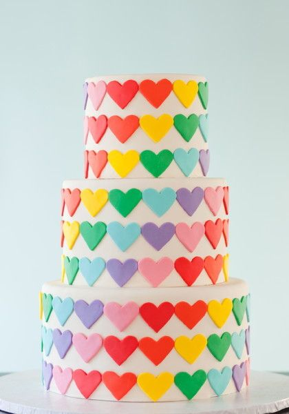 Colorful, modern wedding cake with rainbow fondant hearts {Wild Orchid Baking Company}