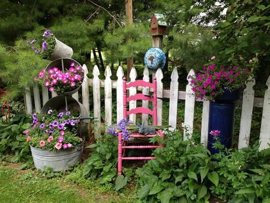 Myra's historic home is surrounded by a creative garden filled with garden art, all salvaged and upcycled in her own way.
