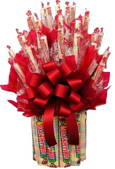 kids candy bouquets | Smarties Candy Bouquet - Candy Bouquet. You could add in gift cards, money flowers or chocolate items for other ages.