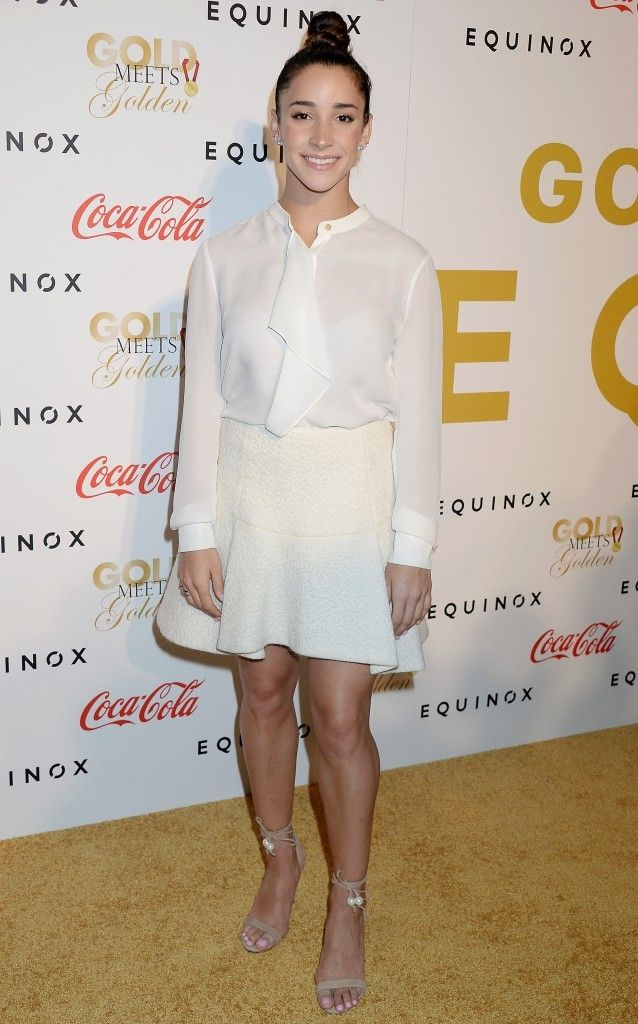 Aly Raisman in all white, looking cute! Check out more beautiful ladies at http://hotminiskirts.oohlala.club