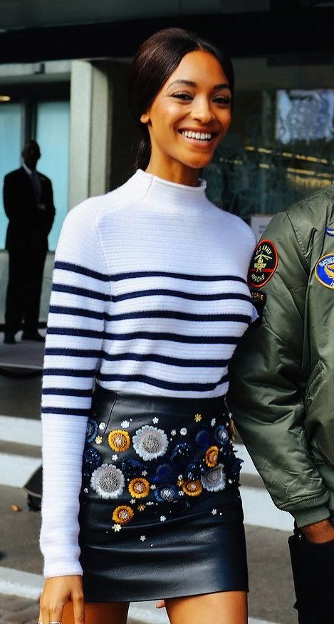 Jourdan Dunn in a striped sweater and embellished leather skirt