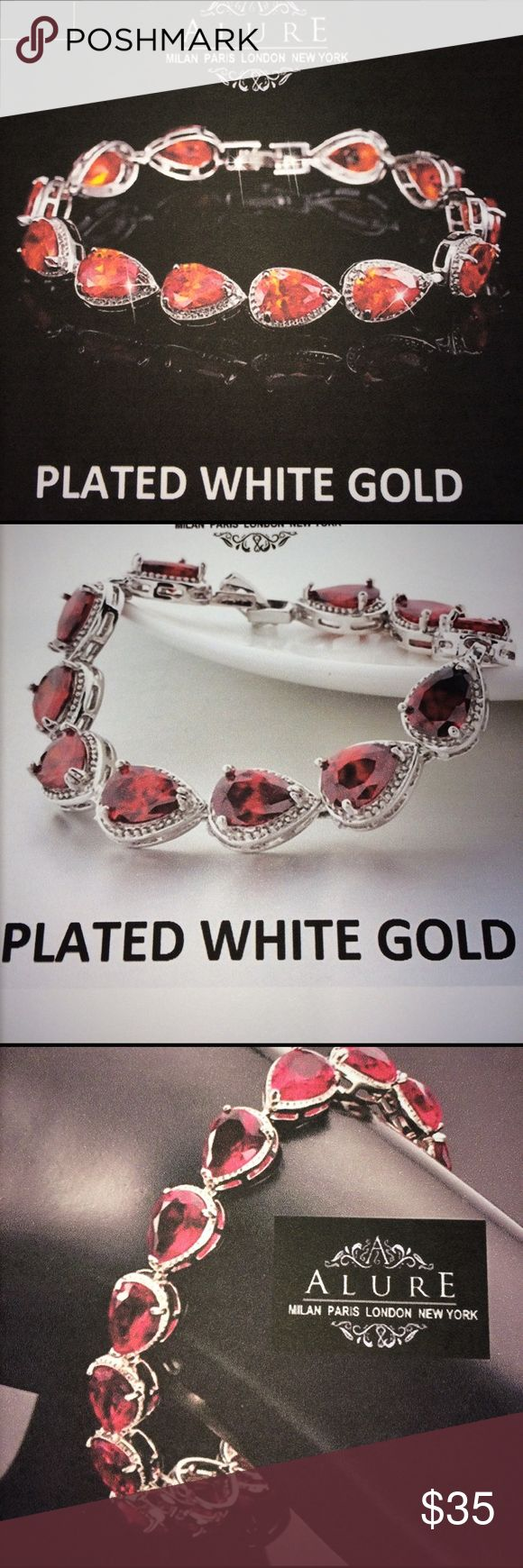 """NEW Elegant Italian Inspired White Gold Bracelet NEW exceptionally strikingly elegant, beautiful Italian inspired bracelet. It comes in beautiful red color and finished with an alluring layer of shiny white gold. It features a teardrop design with a total of 12 stones/chain links. The bracelet length is appropriately: 7.24"""" The bracelet is approximately: 9.4mm Alure Jewelry Bracelets"""