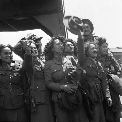 Uniformed Maori members of the Women's Auxiliary Army Corps welcome the Maori Battalion home on Wellington wharf.