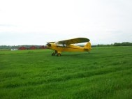 Piper J3 Cub taking off from a Grass Runway in Vermont.