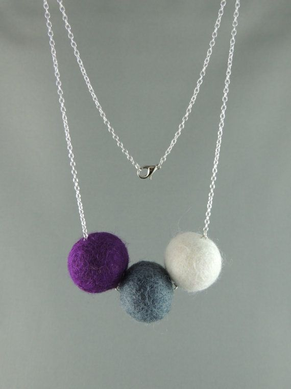 Hey, I found this really awesome Etsy listing at https://www.etsy.com/listing/177524644/beautiful-felt-ball-trio-purple-grey-and