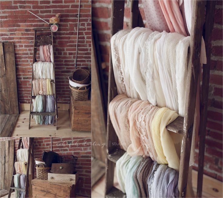 vintage wooden ladder used as wrap storage
