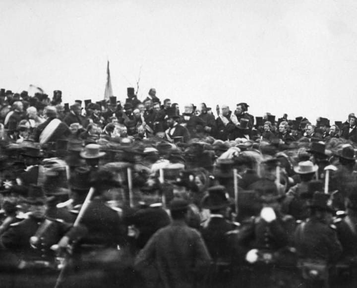 In this 1863 picture, crowds gather around President Abraham Lincoln in Gettysburg, Pennsylvania, as he prepares to deliver his famous Gettysburg Address.