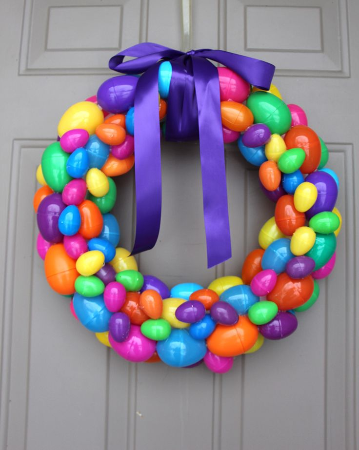 Create an easy DIY Easter egg wreath in under 30 minutes. It will cost less than $20 and it's a great way to reuse plastic easter eggs lying around!
