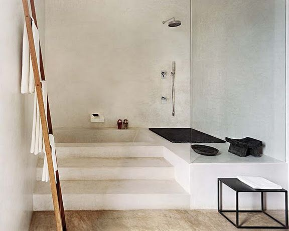 Interesting how the bathtub is on separate level than the rest of the bathroom