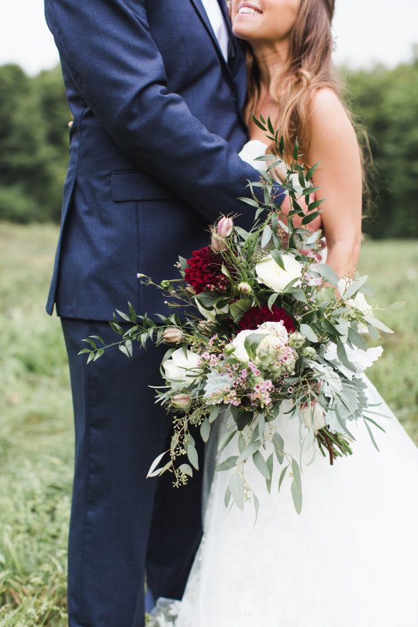 Rustic overflowing wedding bouquet: http://www.stylemepretty.com/vermont-weddings/middlebury-vermont/2015/12/18/rustic-meets-romantic-vermont-wedding/ | Photography: Ashley Caroline - http://www.ashley-caroline.com/