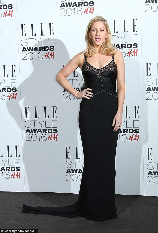 Strike a pose: The floor-length gown perfectly hugged Ellie's curves while the train made ...