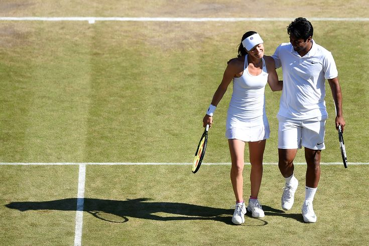 Martina Hingis and Leander Paes in their mixed doubles quarter-final match. Florian Eisele/AELTC Wimbledon 2015