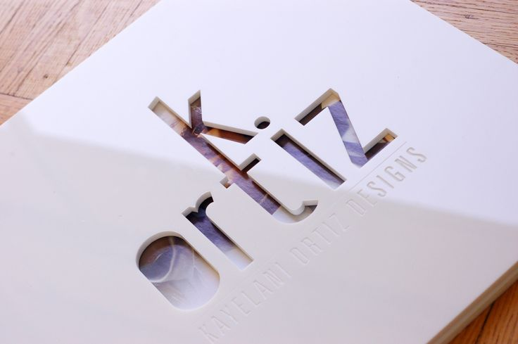 White acrylic screwpost portfolio with cut-out treatment and engraving