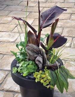 How to build floating plant islands water gardens for Plastic floating pond plants