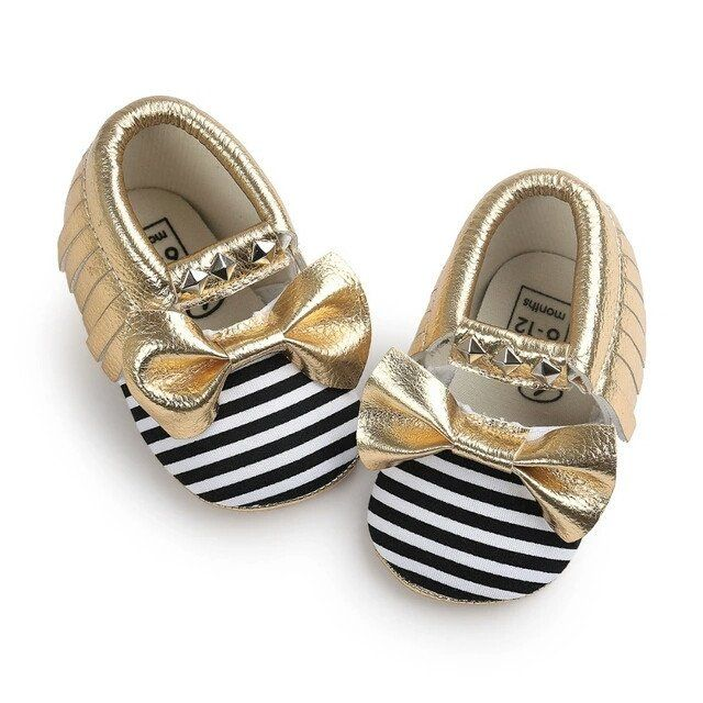 Stripped studded moccs in black and gold black and gold first birthday outfit baby shoes moccasins bow tassels moccs fringe moccs stripes