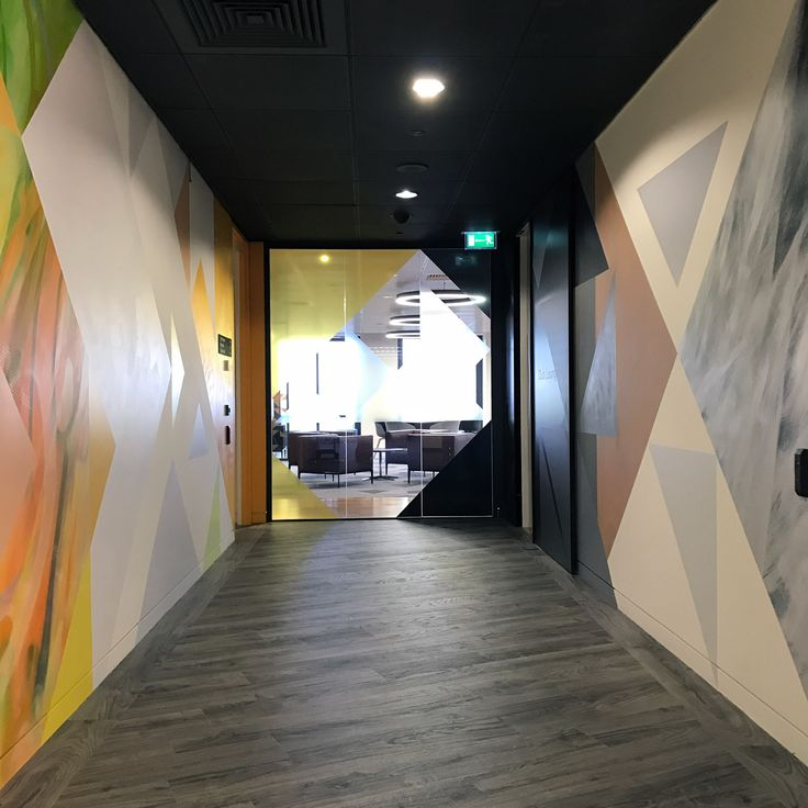 Level 39 - Bringing interest to an office corridor with floor to ceiling hand-painted murals.