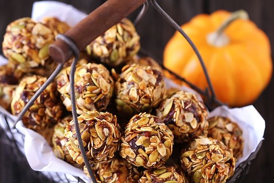 Kick up your energy with this delicious and easy seasonal Pumpkin No Bake Energy Bites recipe! Great as a breakfast, healthy snack, or even dessert!