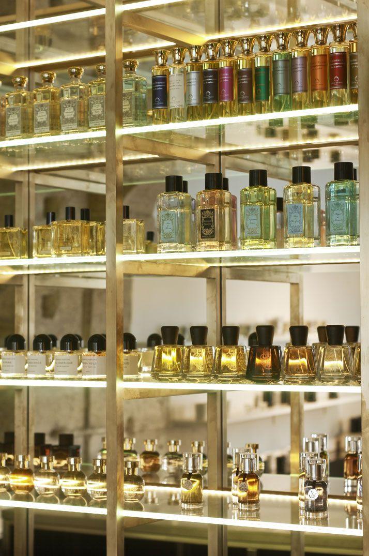 metal framework + glass shelving | The Liquides Perfume Bar in Marais, Paris | Yatzer