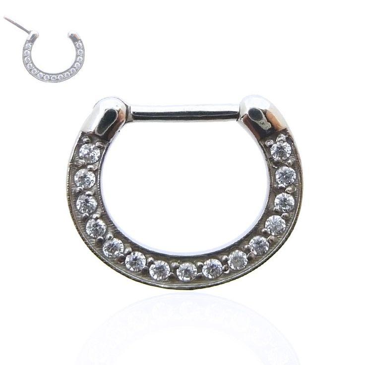 Piercing anneau en acier chirurgical orné de plusieurs brillants griffés. Idéal pour le septum ou l'oreille (rook et daith). Livraison rapide.