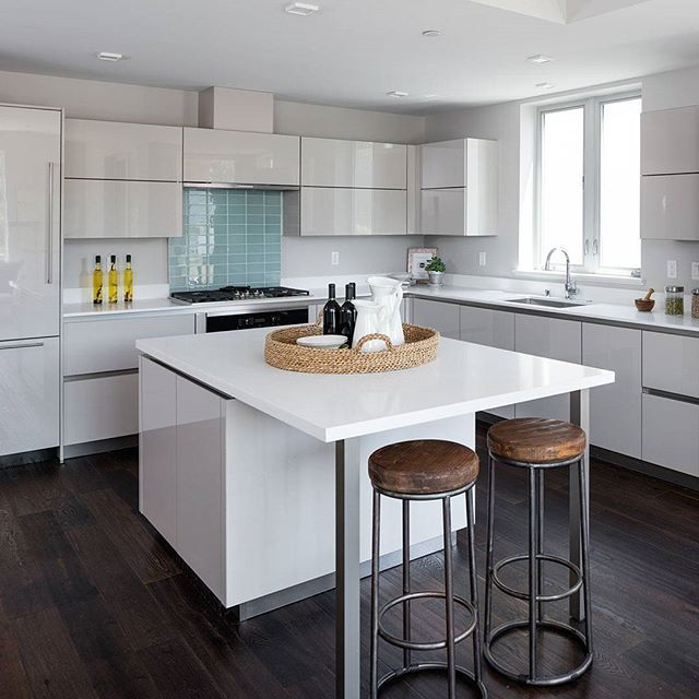 Kitchen Studio of Monterey Inc uses Pure White countertops to create a kitchen that is clean, crisp, and contemporary.