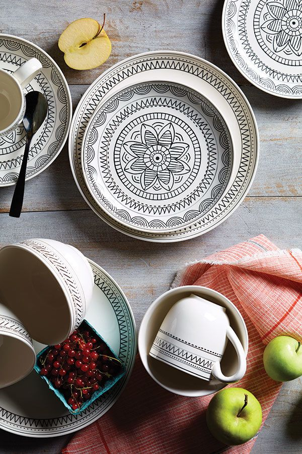 For everyday or in a full dinner-party setting, pairing this black-and-white dinnerware with color really makes it pop.