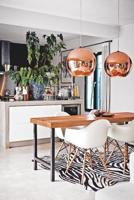 We love this bold dining room look; especially the round copper pendants and retro inspired chairs.
