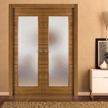 Sanrafael Lisa Glazed Double Fire Door - Model K28V Etimoe Prefinished. #internalwalnutdoors #glazeddesignerinternaldoorpair #sanrafaeldoors